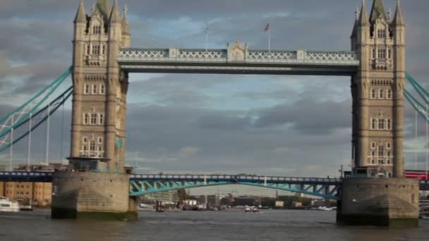 Cars drive and people walk across Tower Bridge