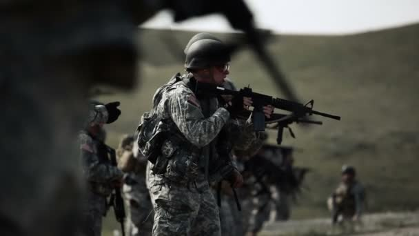 Soldier using rifle during shooting drill