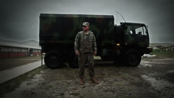 Uniformed soldier in front of truck