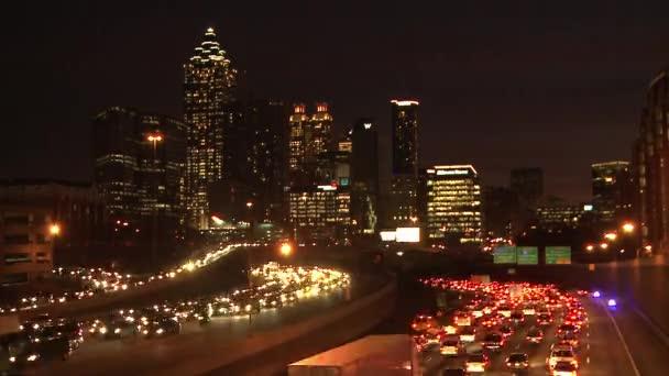 Traffic Flowing Below The Lit Up Atlanta Skyline Stock