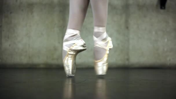 Close up of a ballerinas feet dancing in point shoes.
