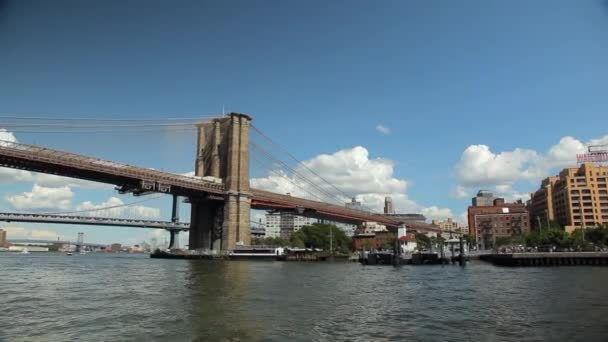 View of the Brooklyn and Manhattan Bridge while floating East River by Ferry.