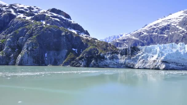 snow covered mountains and ice glaciers floating in the water, Alaska