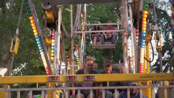 boy and a girl getting off of a carnival ride