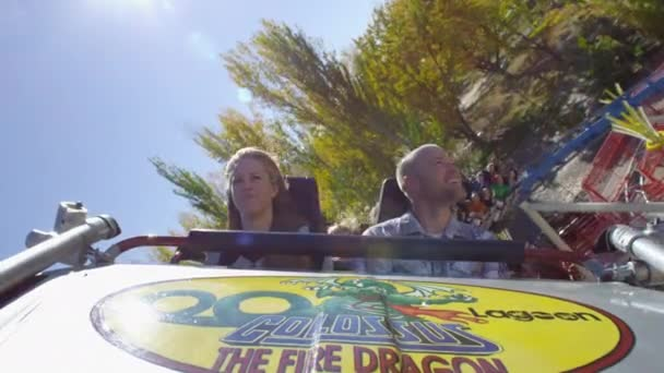 roller coaster ride with a couple in front seat.