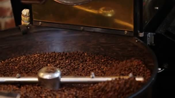 Mixing roasted coffee.