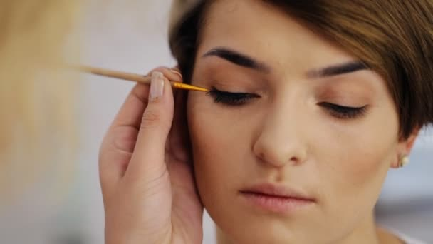 Beautiful female eye with sexy black liner makeup. Fashion big arrow shape on womans eyelid. Chic evening make-up