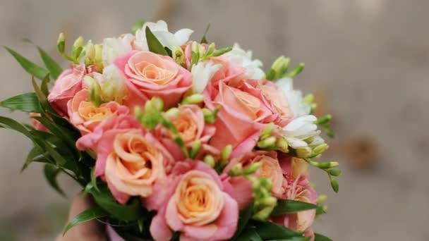 Beautiful flower bouquet with orange pink roses and yellow ranunculus on colorful background