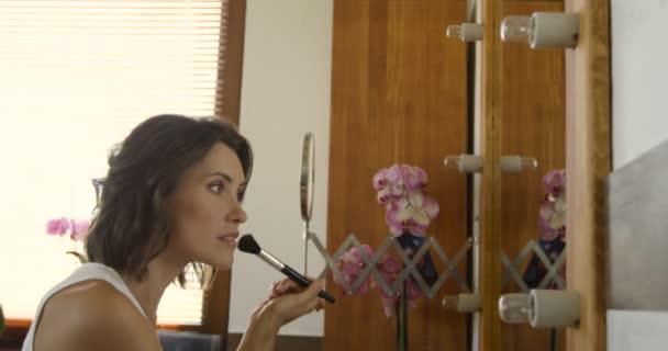 woman applying cosmetic with big brush