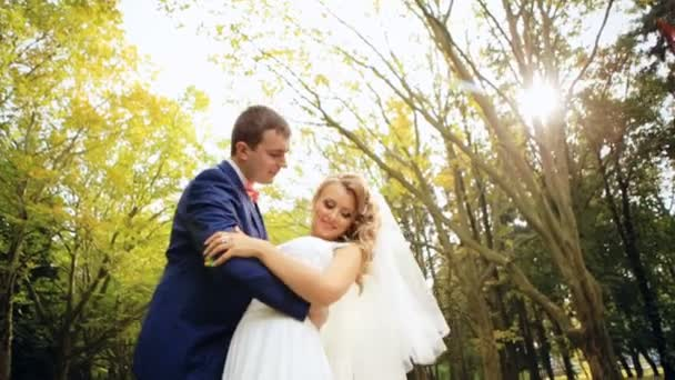Beautiful couple in park shot in slow motion  close up