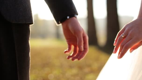 Marry me today and everyday. Newlywed couple holding hands,  shot in slow motion  close up