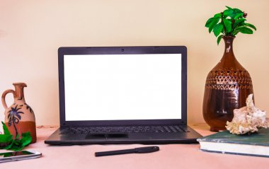 Laptop computer mock up with beautiful islamic style vases and p