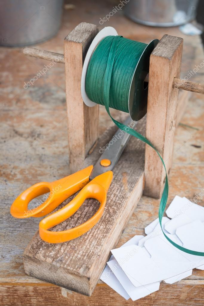 Dark Green Spool of Raffia on Wooden Stand with Scissors