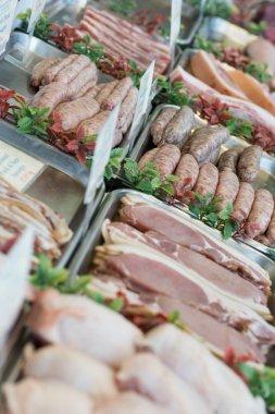 Raw meat in window of butchers