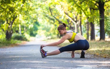 Sport woman doing stretching during outdoor cross training workout