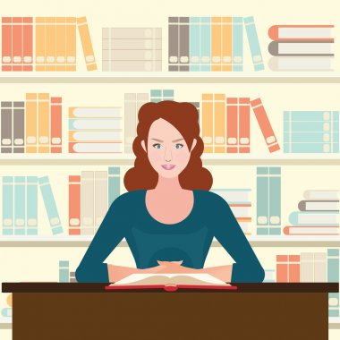 Woman reading book on desk.