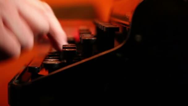 man prints on the typewriter