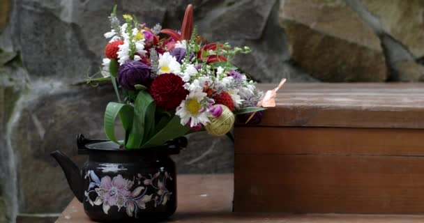 a Bouquet of Flowers in the Tea Pot With Stone Background