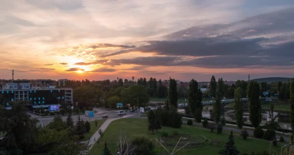 Sunset Over Small City River and a Bridge Over It, Car Traffic Transition From Day to Night (Time Lapse / Timelapse)