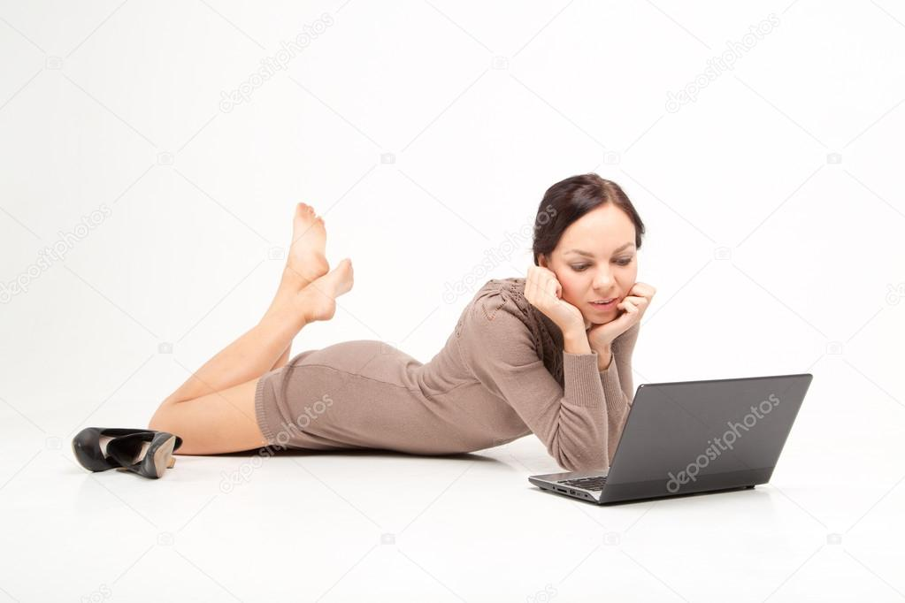 Frelance woman lay on the floor with