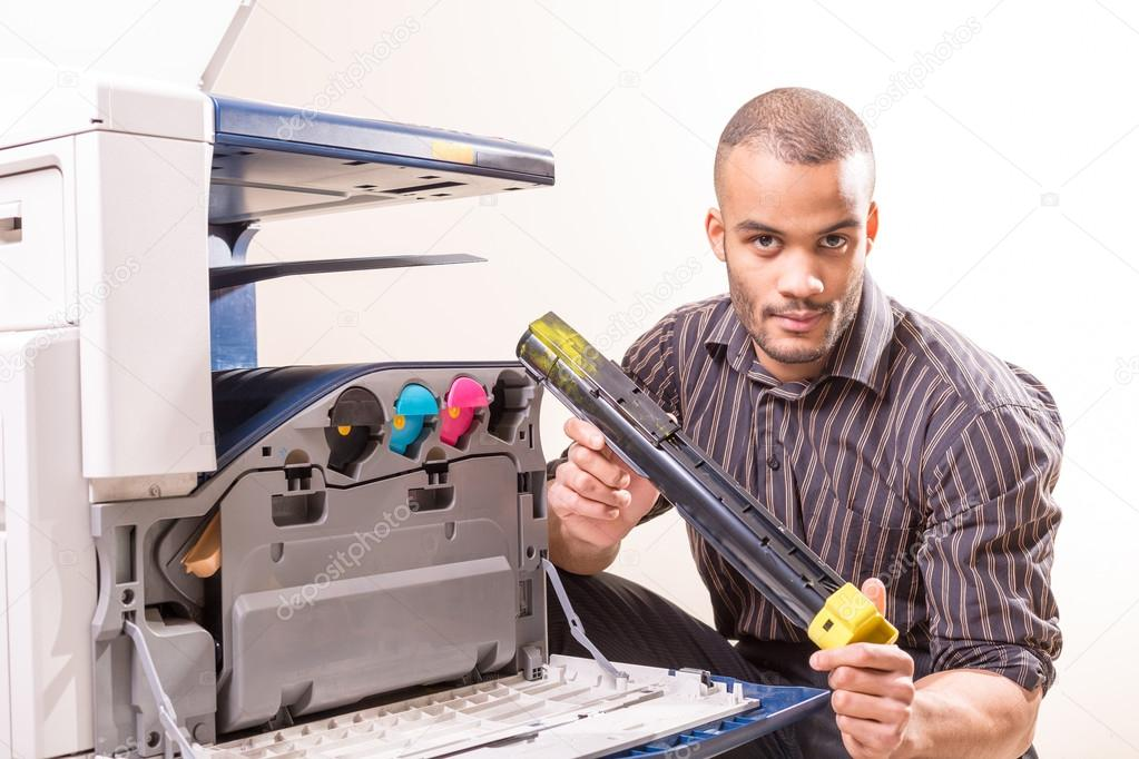 man repairing color printer changing toner cartridge