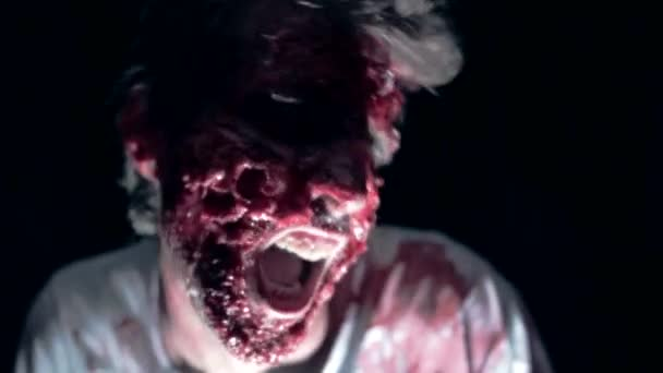 A man with terrible bloody make-up