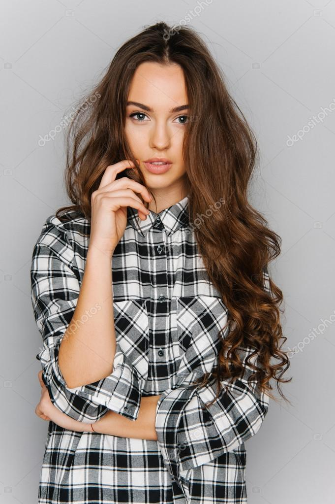 Portrait Of Cute Teen Girl Wearing Stylish Shirt Isolated On Gray Background Fashion For Teenagers In A Photostudio Foto De