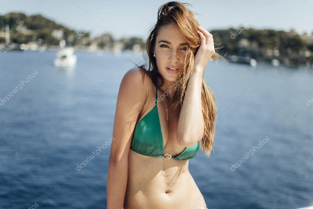 Attractive Cute Tanned Girl On A Yacht Enjoy Bright Sun Light On Vacation Stock Image