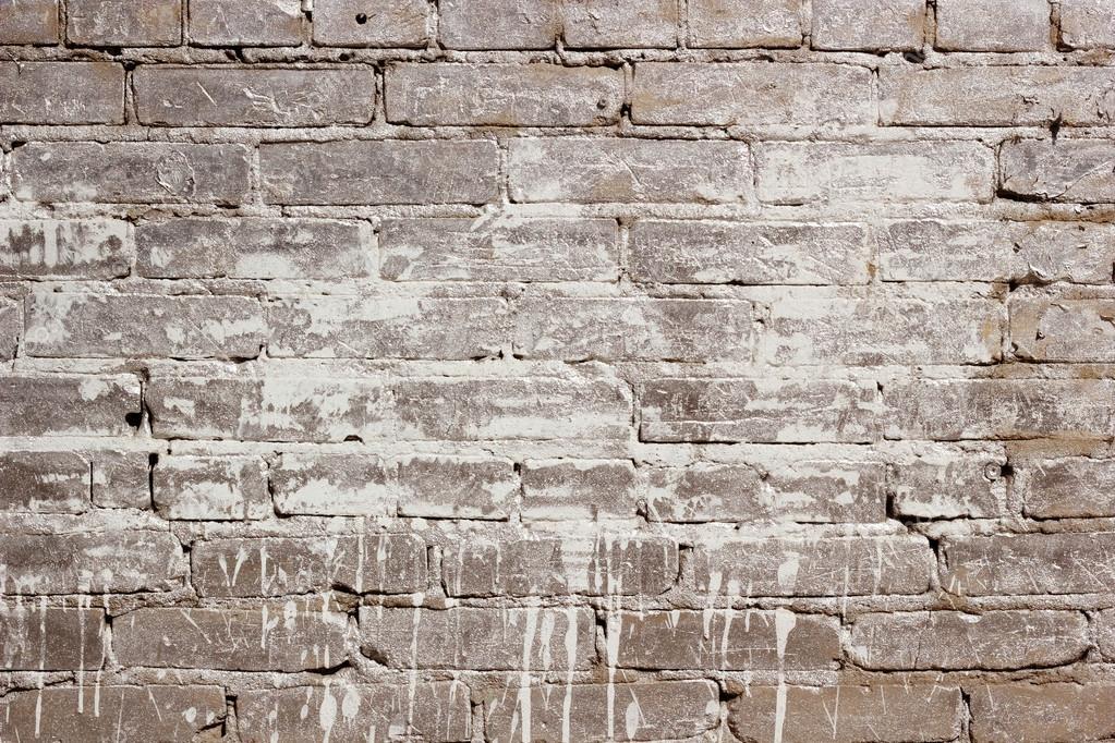 Stenen Muur Verven : Beige bakstenen muur textuur met een verf vlek. de achtergrond van