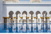 ABU DHABI, UAE - MAY 13, 2014: Sheikh Zayed Mosque in Abu Dhabi, considered to be the key for worship in the United Arab Emirates
