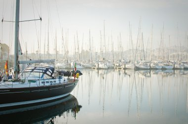 Boats moored during a dense fog in the marina at Newport, Oregon