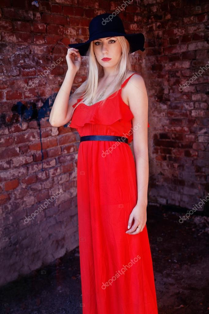 fashionable woman in red dress and black hat — Stock Photo © Ribalka ... 3f5948ffb2c
