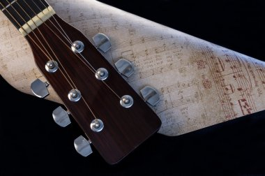 Guitar Headstock and Sheet Music