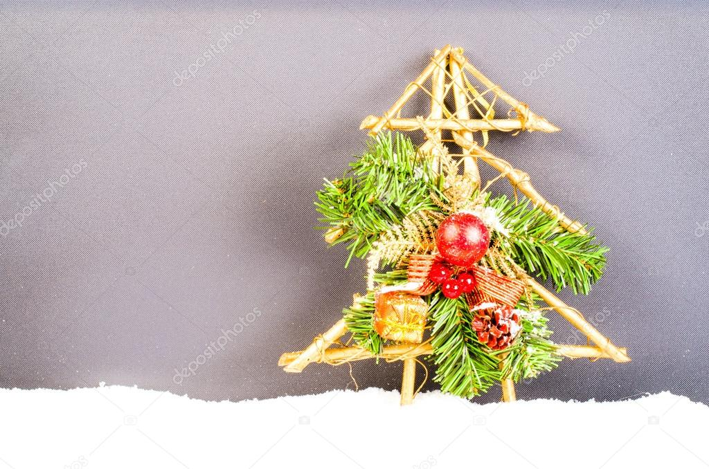 Christmas snowy tree with red balls and gift.  Wooden New Year decoration. Free space for text