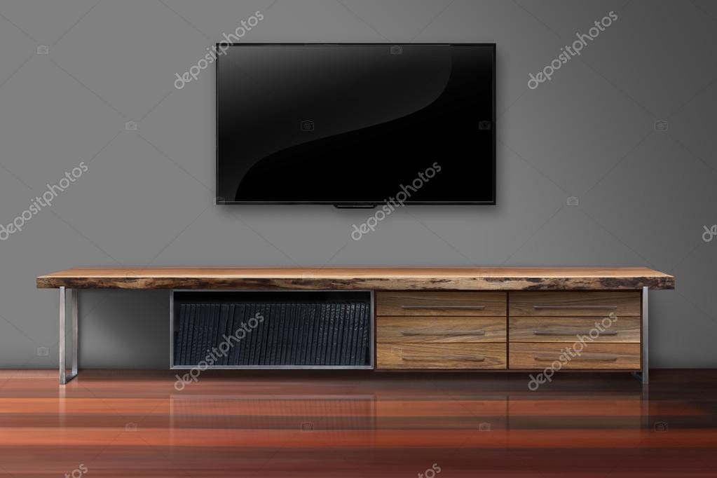 Kleur Muur Woonkamer : Led tv op grijze kleur muur met houten tafel woonkamer u stockfoto