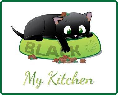 cute black kitten playing in his food bowl