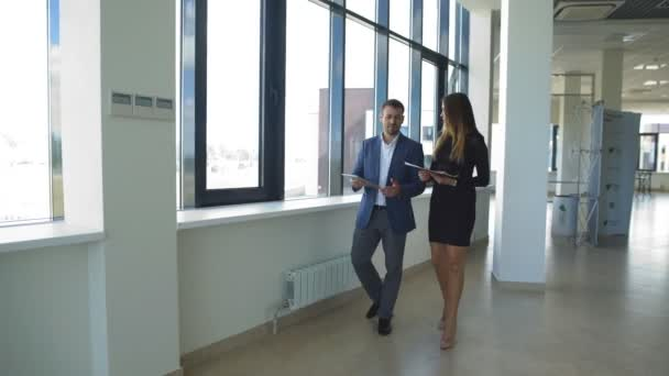 businesswoman and businessman walking on office and discuss ideas