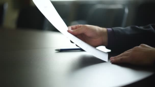 male hand signing contract or subscription form with a pen on a rustic wooden desk