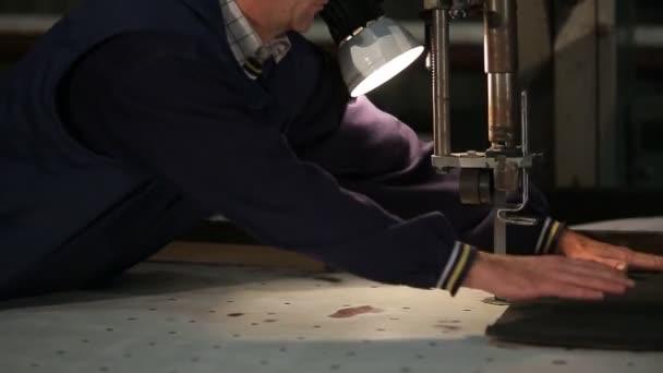 two workers cut polyurethane foam