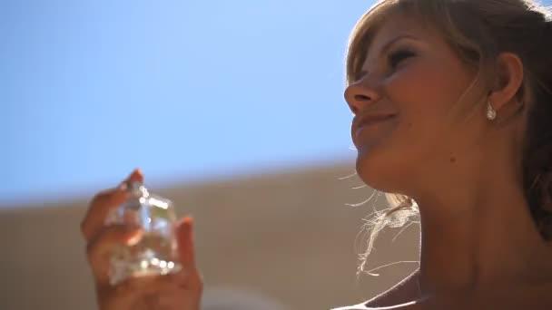 Girl uses perfume