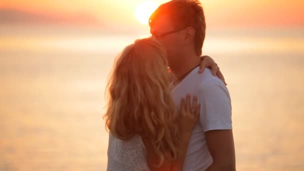 beautiful couple kisses at sunrise
