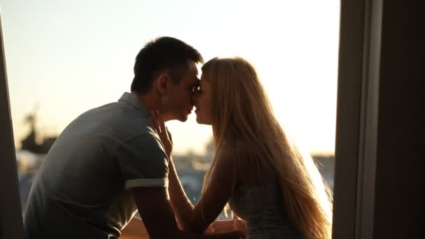Couple kissing on a city roof top