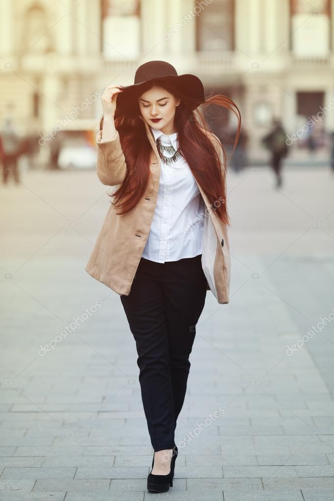 full body portrait of young beautiful lady wearing stylish
