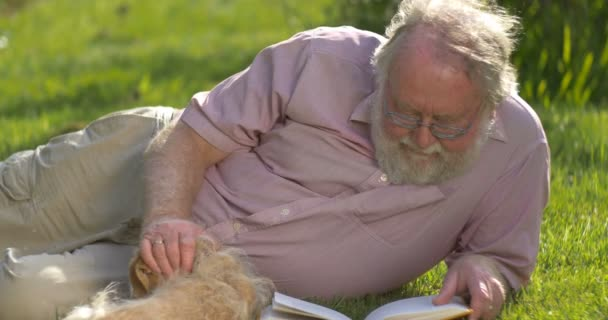 Grandfather retired elderly mature senior adult male in 60s retirement with dog