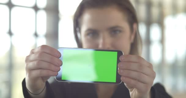 Holding green screen phone career corporate business woman