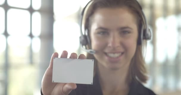 business card hand to camera smiling career corporate business woman holding