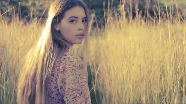young girl walking in long grass