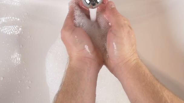 Hands in sink washing with soap to clean for good hygiene