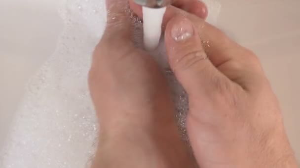 Washing hands in sink with soap to clean for good hygiene