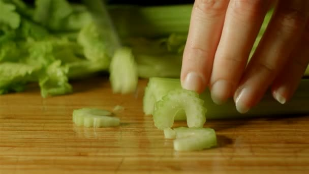 healthy fresh celery food prep cutting up of vegetables and fruit in kitchen
